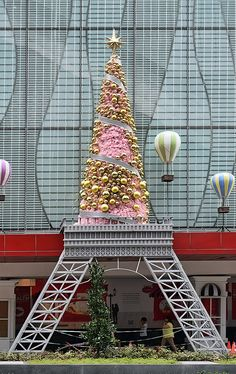 """Xmas tree on Eiffle Tower Paris? Well you can see the famous tower xmas tree decoration in Singapore. Guess where? Centerpoint shopping center on Orchard Road. Read more about where to buy Christmas tree in Singapore by clicking on """"Visit Site"""" button on top."""
