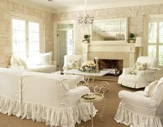 white slipcovers with ruffle skirts