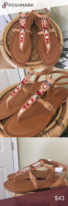 """INDIGO RD. SANDALS Brand new in box.  Super cute sandals by Indigo Rd.  Embroidered thong strap, adjustable buckle closure.  All man made materials.  ALL MEASUREMENTS ARE APPROXIMATE: 10.5"""" (heel to toe) 3.75"""" (across the ball of foot) Indigo Rd. Shoes Sandals"""