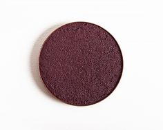 Make Up For Ever I834 Grape Artist Shadow ($21.00 for 0.08 oz.) is a dark purple with warm, reddish-brown undertones and a pearly finish. It had fantastic color payoff, and the texture was soft, smooth, and blendable. It wore well for ten hours before creasing slightly. See comparison swatches / view dupes side-by-side.