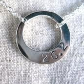 Necklace saying 26.2, which are how many miles are in a marathon...I'd want something like this after my first marathon.