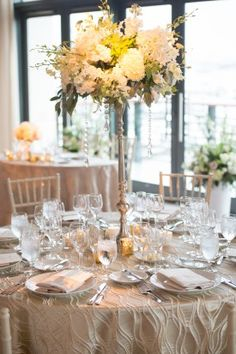tall orchid centerpiece with hanging crystals At Four seasons Hotel Baltimore  Maryland wedding | Photo: Dave McIntosh Photography