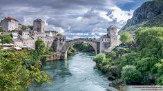 Mostar Bridge in Bosnia Herzagovina. Built in 1566, destroyed during war in 1992, rebuilt in  2003.