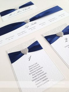 Navy Wedding Stationery | The Ariel Collection - Mounted Table Plan / Seating Chart | Featuring white pebble paper, navy blue ribbon and diamante heart embellishment | Luxury handmade wedding invitations and stationery #byenchanting