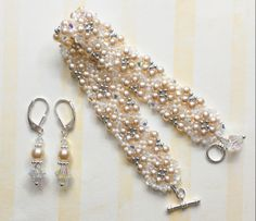 Bridal Lace.  Custom bracelet + earring set.  Sterling silver toggle, ivory and cream glass beads, + Swarovski crystals.  www.aebumble.com