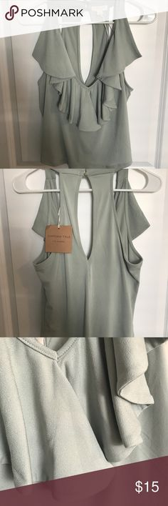 Green Dressy Top Size Large Top with ruffles , sleeveless size large . Tops Blouses