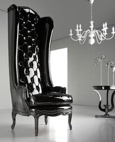 Modern Glamour black lacquered porters chair. Upholstered in high black gloss patient leather with a black lacquered paint finish.