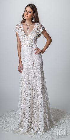 """Rish Bridal 2018 """"Sun Dance"""" Collection – Romantic Timeless Rustic Bohemian Chic Wedding Gown Iris Gown - Rish Bridal Sun Dance 2018 collection elegant fitted fit bridal gown. Bodice and skirt made from elegant romantic bohemian paisley crochet lace over light nude lining with a unique tasseled belt. Light comfortable flattering bridal gown. Comfortable flattering unique bridal gown. #RishBridal #SunDance #IrisByRish #BohoChic #BohoGown #WeddingDress #Romantic #Bride"""