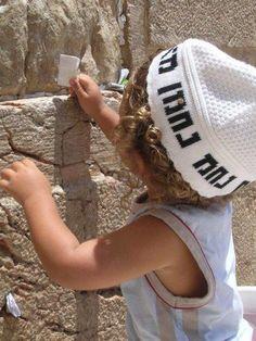 Little child praying at the Western Wall/HaKotel
