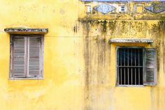 Hoi An Vietnam - Life Abundant Blog, Hoi An Vietnam, Best places to visit in Hoi An Vietnam, Hoi An Photography, Hoi An Vietnam Travel Tips, Yellow Building, yellow windows