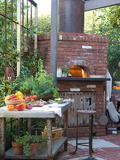 outdoor kitchen with brick pizza oven