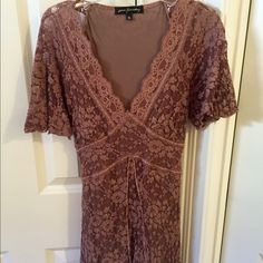 Anthropologie Top Pretty copper/brown short sleeve lace tie back blouse. Lined except arms. Great with jeans and heels! Anthropologie Tops Blouses