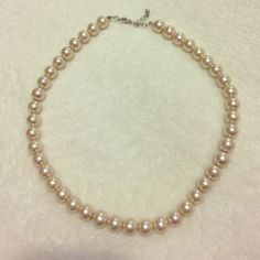 Beautiful champaign pearl Necklace Beautiful champaign faux Pearl necklace. Perfect condition, only wore it once. Really pretty accessory for the holidays. Jewelry Necklaces