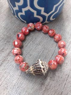 Check out this item in my Etsy shop https://www.etsy.com/listing/563463314/hawaiian-cone-shell-bracelet