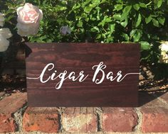This beautiful rustic, elegant stand alone wooden cigar bar sign is perfect for your wedding. The wood can be stained either mahogany (shown), honey, or english chestnut. The writing can be wither white, mint, blush pink, gold, copper or silver. The quote can be changed to any quote youd like! The sign measures 8.5 tall, 14 long and 1 thick. Please message me if you have any questions, I am happy to answer any of them! At checkout, Please note that no two pieces of wood can be identical...