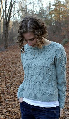 Sazerac adds a little drama to the classic cabled pullover. A beautifully intricate motif is the focus of the design, and it really stands out when worked in this pale blue from YOTH's gorgeous palette of colors. Their Big Sister yarn is soft and round and addictive. Plus it really loves a good cable.