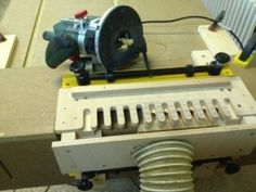 Dovetail Jig - Homemade dovetail jig adapted from a surplus commercial unit. Resulting jig utilizes a template constructed from birch plywood and is anchored to the router fence in use.