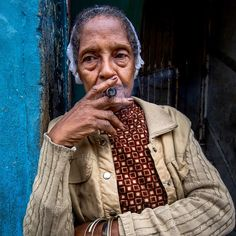 """insatiabletraveler: """" There are ladies who smoke cigars in Cuba who do it so that tourists will take a picture and pay them for it. They're usually dressed up in some Carmen Miranda - looking outfit hanging out in touristy areas. Then there are women..."""