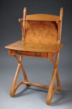 WOW! Joan Busquets i Jané (1874-1949) - Ladies Writing Desk. Carved Walnut & Oak with Brass Hardware. Barcelona, Spain. Circa 1900. 124cm x 72cm x 43cm.