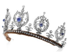 The Princess Thyra Sapphire Tiara  ~ the  tiara features five diamond elements studded with a central sapphire, set on a simple diamond base. Princess Thyra never married, and when she died, she left the tiara to her niece, Princess Caroline-Mathilde of Denmark,..then to her only daughter Princess Elisabeth.