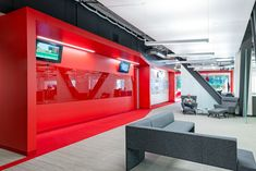Modern office interior with red color accents from the Blitz Design Studio #