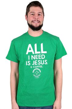 """Themed after the popular worship song, """"Just Give Me Jesus,"""" the message of this graphic tee is that with Jesus, we have all things. However, coffee lovers humorously like to add that coffee is nice, too. Perfect gift for the coffee lover in your life!   This short-sleeved, kelly green heather T-shirt is made of 50 percent cotton and 50 percent polyester. The wording on the front is written in white and reads: """"All I need is #Jesus. & #coffee."""""""