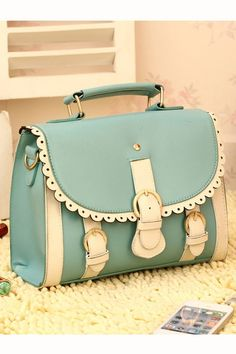 http://www.oasap.com/handbags/6152-three-pin-buckle-detail-makeup-case-with-lace-trim-to-flap.html