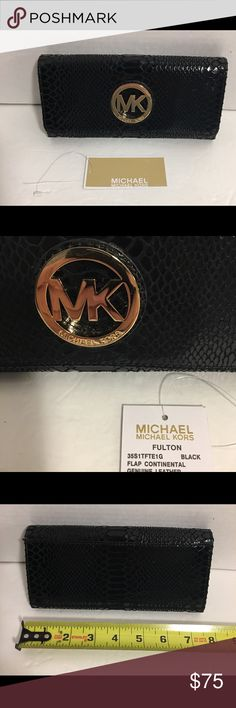 Gorgeous Michael Kors Fulton Black Leather Wallet Beautiful Michael Kors Fulton black leather snakeskin styled wallet. This gorgeous wallet is in excellent condition! Comes with original tag! From a smoke/pet free home Michael Kors Bags Wallets