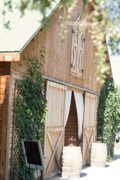 Grow vines on the barn to soften. Love the curtains
