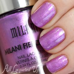 Milani Fierce Foil: ☆ Rome ☆ ...  swatch via @alllacqueredup ... a sweet, mid-tone violet shimmer nail polish with crystal and gold foil flecks.