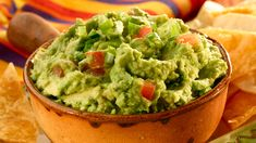 You'll want to stock up on chips because this delicious guacamole recipe will keep you coming back. All you need are a few simple ingredients and a couple minutes to mash the avocados. Serve this guacamole at a party, and your guests won't get enough. Rocco's Tacos, Nachos, Easy Appetizer Recipes, Appetizers, Great Recipes, Favorite Recipes, Comida Latina, Le Chef, Mexican Food Recipes