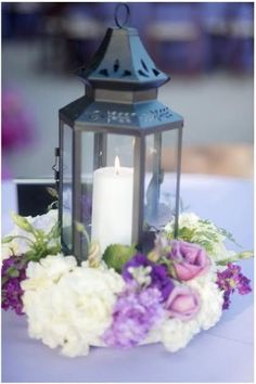 guest table- with more wildflowers and with wood lantern
