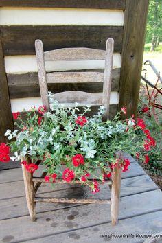Is your chair missing its seat? Turn it into a rustic flower planter for your front porch.  Get the tutorial at Simply Country Life.   - CountryLiving.com