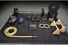 Get RXd Elite RX Home Gym Package. CrossFit and functional training home gym essentials. Weightlifting: Men's Get RXd WOD Bar 5.0, 320-pound bumper plate set, (2) 2.5-pound cast-iron Olympic plates, (2) spring collars, (5) kettlebells. Conditioning: 20-pound wall ball, EZ Speed Rope, 15-foot manila climbing rope 25-lb slam ball. Gymnastics: Pair of 1.11-inch wood rings, back support pad, pair of maple parallettes.