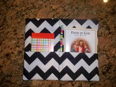 A great little place to keep your Faith in God book with a notebook and pencil!  What you need:  Fabric 8X12 cut on fold (so unfolded it's 16X12) the pocket is 4X12 cut on fold.  Iron on interfacing to the wrong side of fabric.  Attach velcro to the pocket on each side, 1 inch from the side to leave room for seam. Sew it all together, leave an opening to turn inside out.  Sew 2 lines down the middle for the pencil.