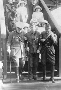 William Angus, 8th Battalion, The Highland Light Infantry, flanked by Lord Newlands, President of the Territorial Army Association, and Lieutenant James Martin.He was awarded the Victoria Cross for his actions at Givenchy, and in earning it suffered some 40 wounds, including the loss of an eye. Before the war, he worked as a miner and made one appearance for Celtic FC. When King George V remarked on the number of wounds, Angus reputedly quipped 'Aye, sir, but only 13 were serious.'