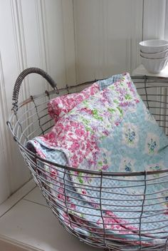 LOVE the wire basket...need one for all of our cozy blankets in the living room!