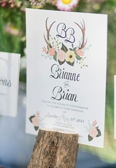 Gorgeous hand drawn floral and antler wedding invitation suite