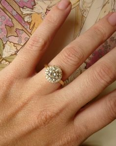 it huuuurts us.  the precious. Round Moissanite and Diamond Halo Ring - 14k Yellow Gold. $2,295.00, via Etsy.
