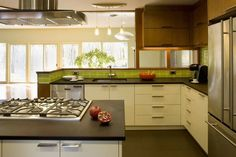 counter with cooktop is same depth as we think. Like the richlite counters and the green backsplash