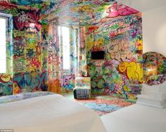 A French hotel is using street art as a head-spinning design motif.  While most might be accustomed to seeing graffiti-lined walls in subway stations or abandoned buildings, owners of Au Vieux Panier hotel in Marseille had other ideas.   They commissioned graffiti artist Tilt to design what they call the 'Panic Room'.