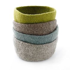 Handmade felt bowls. They look like they might be knitted and fulled...