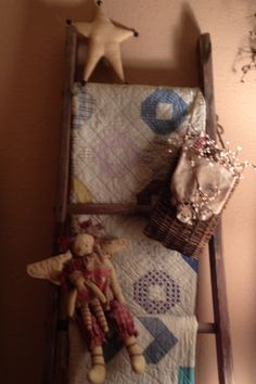 Antique Quilts...on an old ladder.