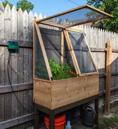 Herb Garden project - HOME SWEET HOME - Craftster HOLY CRAP. This is amazing. Raised herb garden, with screened enclosure and solar powered watering system. Super cool DIY that could actually keep the damn jays & crows out of my patio plants. Raised Herb Garden, Diy Jardin, Diy Greenhouse, Greenhouse Wedding, Homemade Greenhouse, Underground Greenhouse, Portable Greenhouse, Cold Frame, Patio Plants