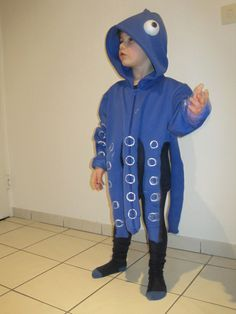 This simple octopus costume is made from an over-sized hoodie. Puffy paint can do the circles/eyes and just cut the fabric to make 8 legs.
