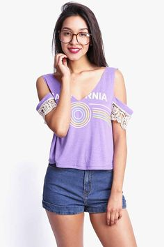 Adorable retro inspired graphic tee a raw edge cut neckline and cutout sleeves…