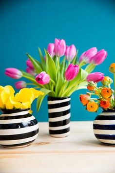 Easy Spring Centerpieces tulips in black and white stripe vase