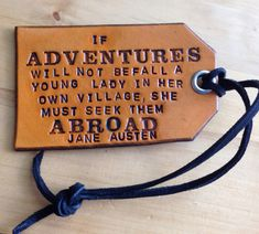 """Leather Travel Luggage Tag with the Jane Austen quote for ladies who enjoy the excitement of exploring new territories. I can relate to this one! The quote reads """"If adventures will not befall a young lady in her own village, she must seek them abroad."""" Jane Austen Hand stamped so it will never be machine straight. I like the idea of an old west look. Handmade adds charm to anything. Also hand cut, dyed, and protected with a water resistant finish. Attach to: luggage bag briefcase backpac..."""