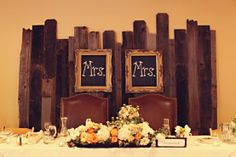 I love the boards as a backdrop behind the head table seats ... Mrs. and Mrs. #lesbian #wedding ♥