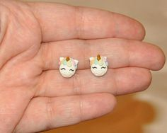 You are looking at adorable detailed mini pastel rainbow unicorn stud earrings. These cute little earrings are perfect as gift for fantasy enthusiasts and unicorn lovers. The hairs are made with pastel colors, with white body and golden horn. These are handmade from polymer clay, no